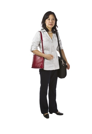 causal: Asian women carry purse and laptop in business causal clothing on white background