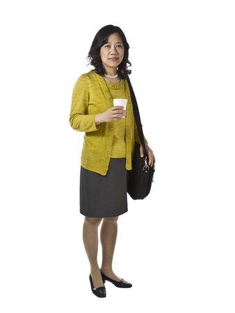 causal: Asian women with paper coffee cup and laptop case dressed business causal on white background Stock Photo