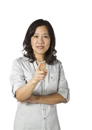 causal clothing: Asian women in business causal clothing pointing index finger on white background