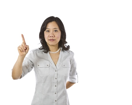 causal clothing: Asian women point finger in business causal clothing on white background