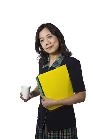 causal clothing: Asian women carrying folders in business causal clothing on white background Stock Photo