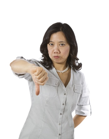 causal clothing: Asian women with thumb down in business causal clothing on white background