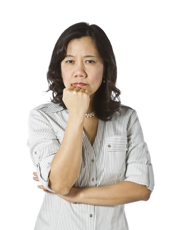 causal clothing: Asian women in a decision mood wearing business causal clothing on white background