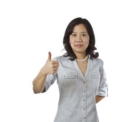 causal clothing: Asian women with thumb up in business causal clothing on white background