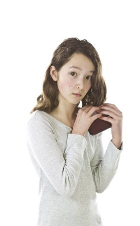 preteen asian: Asian Preteen girl hiding cell phone on white background Stock Photo