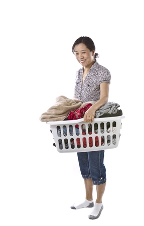 house wife: Asian lady with full laundry basket while wearing causal clothing on white background