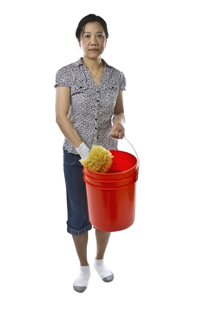 causal clothing: Asian lady carrying large bucket with sponge while wearing causal clothing on white background