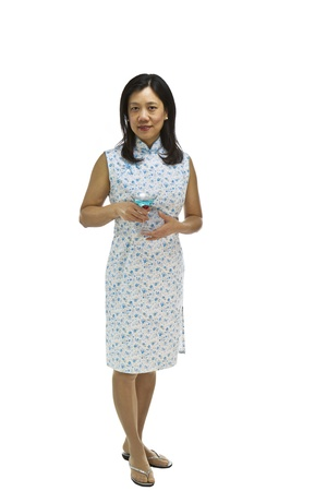 Asian Woman wearing causal dress with drink in hand on white background