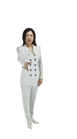 Asian woman dressed in business formal white outfit with hand extended on white background photo