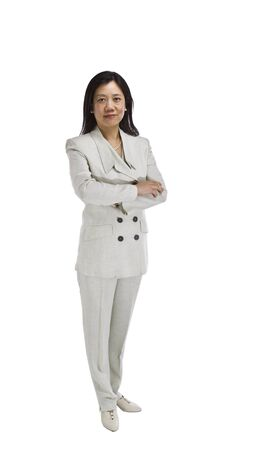 Asian woman dressed in business formal white outfit with arms crossed on white background Stock Photo - 12475951
