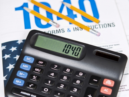 Standard IRS tax forms with pencils and  calculator  photo