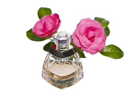 merchandise: Golden color perfume bottle with pink flowers on white background Stock Photo