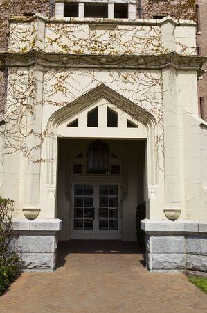 door way: Large door way into building with vines covering the stone Stock Photo