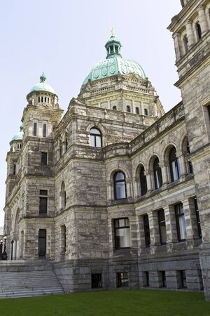 vancouver island: Side view of capital building of Victoria Canada with light blue sky background