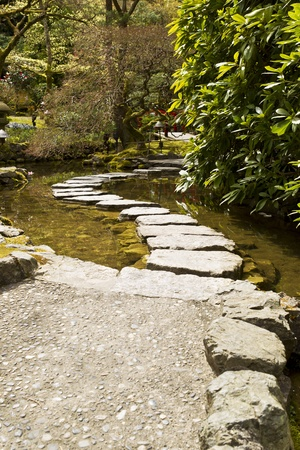 Stepping over water in Japanese Garden photo
