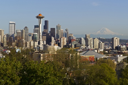 space needle: Seattle city skyline taken from Kerry park in Spring time with blue sky and mount rainier in background Stock Photo