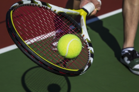 tennis racket: Tennis forehand slice from baseline of outdoor court