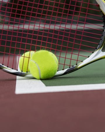 Two Tennis Balls and Racket on Outdoor Court Stock Photo - 13866776