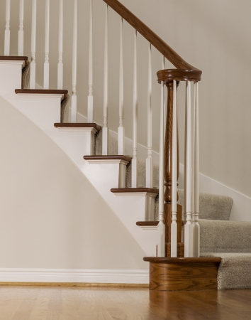 white trim: Wooden oak staircase with carpet steps and white molding