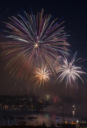 Large wheel shaped like fireworks off Lake Union Washington during 4th of July  photo