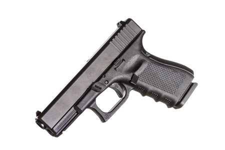 Modern compact pistol on white background  photo