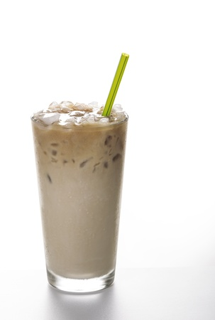 iced: Fresh Iced Coffee with green straw on white background  Stock Photo