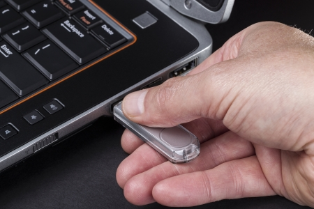 Hand inserting usb thumb drive into computer Stock Photo - 14803592