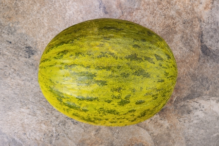 Fresh Santa Claus melon on natural stone background