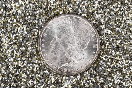 coin silver: High Quality American Silver Dollar in Gold and Silver glitter background