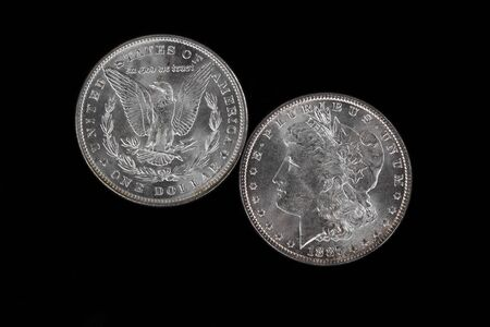 american silver eagle: Obverse and Reverse of American Silver Dollar isolated on Black Background