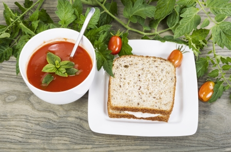 Garden fresh tomato soup in white bowl and tuna fish sandwich in white plate on Wooden & Fresh Tomato And Basil Soup With Melon Tuna Fish Sandwich Cucumber ...