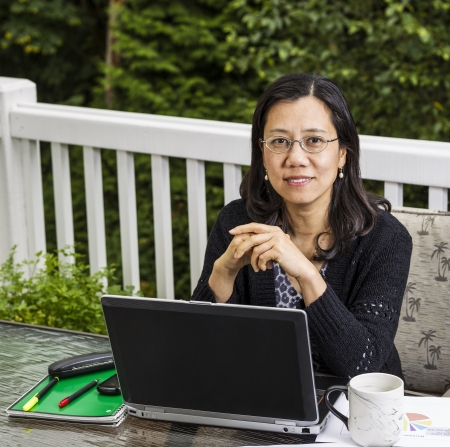 Mature women on outdoor deck working from home office  Stock Photo - 15584485