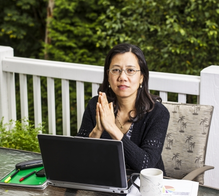 Mature women on outdoor deck thinking while working at home office Stock Photo - 15584487