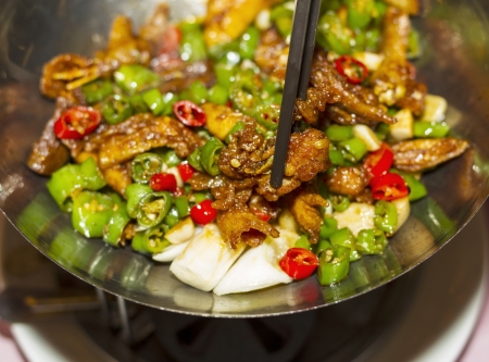 Spicy hot Chinese dish made in China with chop sticks in pan photo