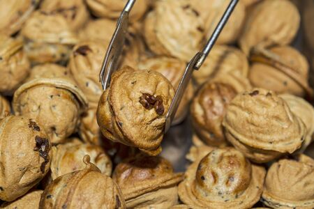 prongs: Chinese walnut filled muffin being held by a set of prongs  Stock Photo