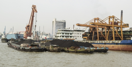mining ships: Cargo ships loaded with rare earth soil for export in China  Stock Photo