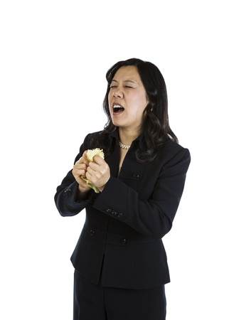Mature Asian woman in an angry mood on white background Stock Photo - 16633963