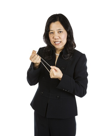 Mature Asian Woman Pulling Rubber Band in Anger on white background  Stock Photo - 16633969
