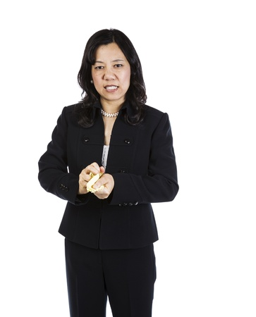 Mature woman showing frustration with crushed paper in hands on white background Stock Photo - 16633966