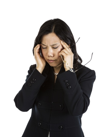 Mature Asian woman with a stressful moment holding glasses on white background  photo
