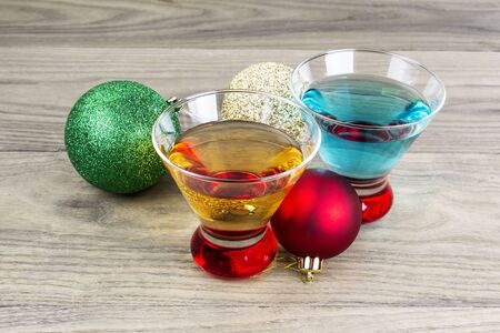 Holiday drinks with Christmas ornaments on wooden table  photo