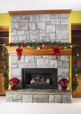 comfortable: Natural Gas fireplace decorated for the holiday season