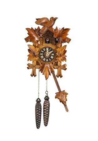 Crafted wooden made cuckoo clock with birdie out of house at 2 OClock position with arm in swing motion on white background   Stock Photo