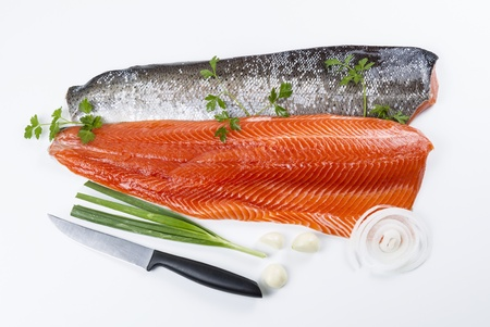 Wild Salmon Fillets with parsley, onion, garlic and knife on white background  photo