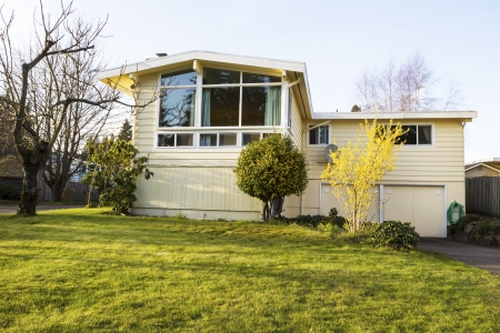 Horizontal photo of older residential home in early spring with front yard and bare trees Stock Photo - 18658453