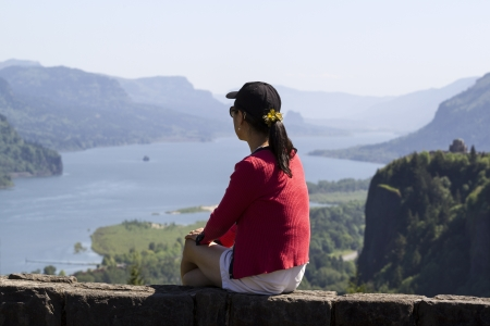 gorge: Horizontal photo of mature woman looking at Columbia River Gorge located in the Northwest section of the United States Stock Photo