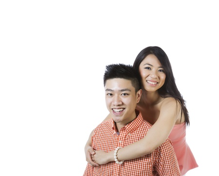Photo of young adult couple displaying happiness on white background  版權商用圖片
