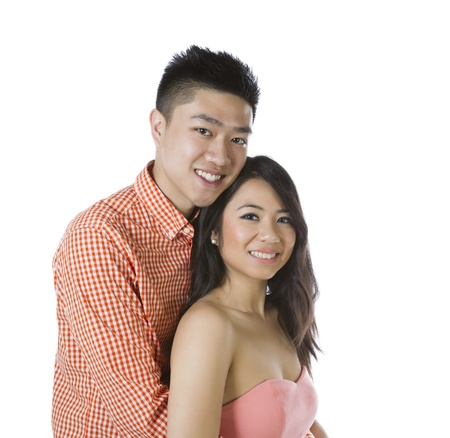 adoring: Photo of young adult couple with man holding his woman on a white background