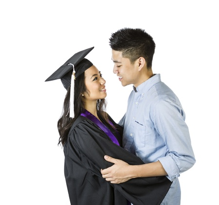 Photo of young adult woman, dress in graduation gown and cap, receiving congratulations from her boyfriend on a white background photo