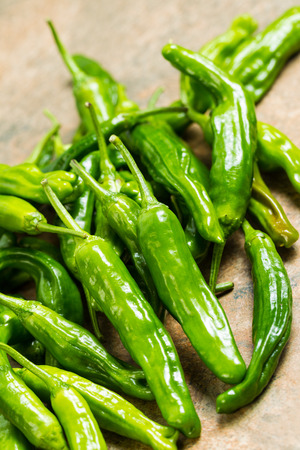 fresh, green sweet peppers on stone counter top Stock Photo - 22478964